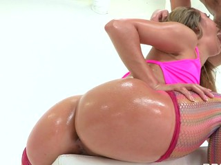 Kristina shakes her bubble butt during the time that Manuel Ferrera pours some oil all over her..