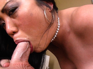 This Oriental cutie enjoys having large male rods down her mouth!