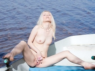 What can a beautiful golden-haired do all alone in a boat in the middle of a lake? Find out in..